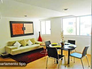 Una sala de estar llena de muebles y una gran ventana en Departamento en venta en Doctores 57m²