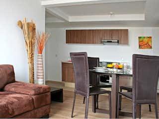 Una sala de estar llena de muebles y una mesa en Departamento en venta en Doctores 53m²