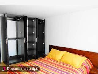 Un dormitorio con una cama y una cómoda en Departamento en venta en Doctores de 2 recámaras