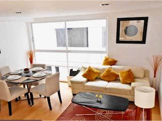Una sala de estar llena de muebles y una televisión de pantalla plana en Departamento en venta en Doctores de 57m²