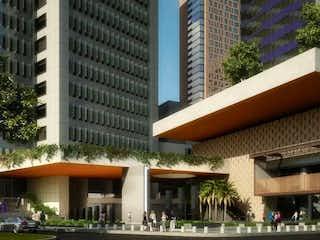 Un edificio con un gran edificio en el fondo en Departamento en Venta en Polanco Torre Colibrí