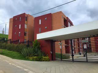 Un edificio de ladrillo rojo con un edificio de ladrillo rojo en SE VENDE APTO CALERA BOGOTA CUNDINAMARCA