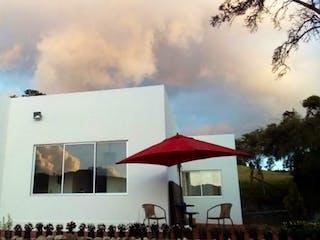 Un par de paraguas que están al lado de un edificio en Casa en venta en Río Frío Oriental de 1458m² con Jardín...