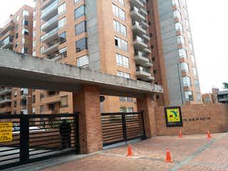 Un semáforo sentado frente a un edificio alto en Apartamento en venta en Barrio Colina Campestre 141m² con Gimnasio...