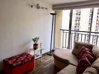 Una sala de estar llena de muebles y una ventana en Apartamento en venta en Iberia, 64mt con balcon