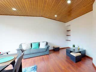 Una sala de estar llena de muebles y un suelo de madera en Apartamento En Venta En Bogota Puente Aranda