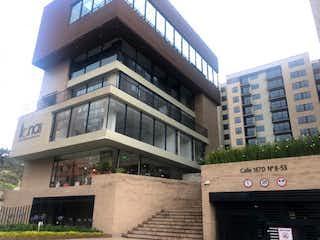 Un edificio alto con un reloj en la parte superior en Venta de Apartamento en Santa Teresita