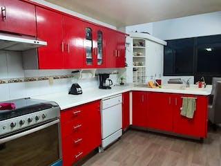 Una cocina con una estufa roja encima del horno en Casa en Venta en Paseos del Sur Xochimilco