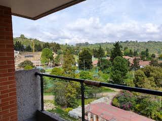 Una vista de una ciudad desde una ventana en APARTAMENTO EN ALTOS DE LA COLINA