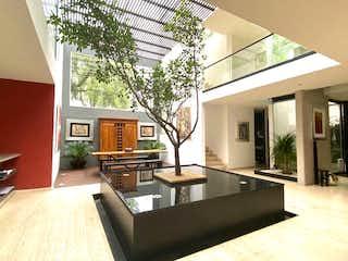 Una sala de estar llena de muebles y una ventana en Preciosa  casa en condominio  Granizo Jardines del Pedregal Álvaro Obregón