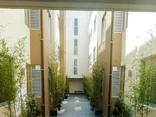 Una vista de una calle con un gran edificio en Departamento Roof Garden común Albert, BJ