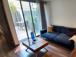 Una sala de estar llena de muebles y una ventana en Departamento en venta en Nápoles, 64m²