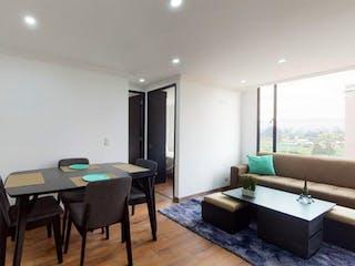 Una sala de estar llena de muebles y una televisión de pantalla plana en Apartamento En Venta En Mosquera Mosquera