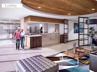 Una sala de estar llena de muchos muebles en 103 Senior Living Aptos