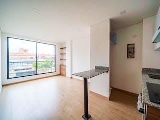 Un cuarto de baño con lavabo y un gran espejo en Apartamento en venta en Batán de 1 habitación