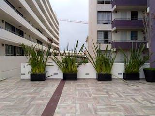 Un gran edificio con una planta en maceta en Departamento en venta en Dr. Alfonso Ortiz Tirado 65m² con Gimnasio...