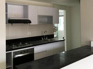 Cocina con fogones, fregadero y microondas en ZNE-10 Apartamento en venta, Madrid