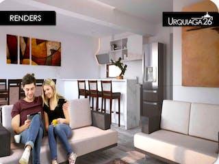 Un par de mujeres sentadas en la parte superior de un sofá blanco en Urquiaga 26