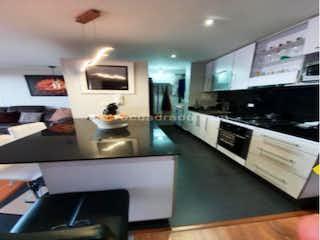 Cocina con fogones, fregadero y microondas en Apartamento en venta en La Capuchina, 115m² con Bbq...