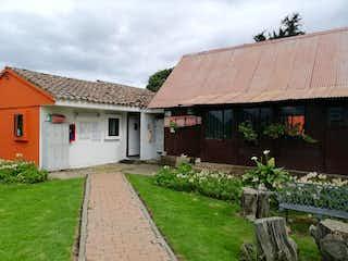 Una casa con un banco y una casa en Lote en venta en Hacienda San Simón de 3090m²