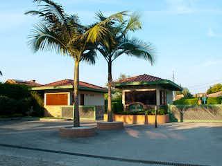 Una palmera delante de una casa en Lote en venta en Guayabito de 1786m²