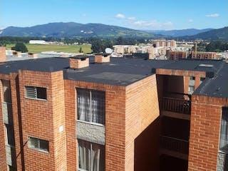 Un gran edificio de ladrillo con una torre de reloj en Apartamento en venta en Casco Urbano Zipaquirá de 3 alcobas
