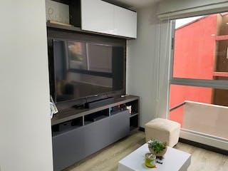 Un cuarto de baño con lavabo y bañera en Apartamento en venta Chapinero