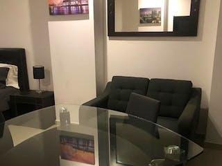 Una sala de estar llena de muebles y una televisión de pantalla plana en Allure condesa