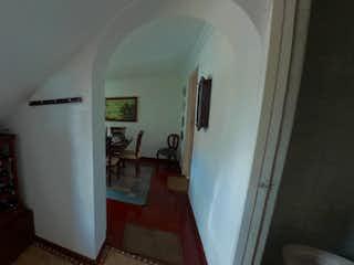 Una vista de una habitación con una puerta abierta en Casa en venta en Cedro Golf 203m² con Jardín...