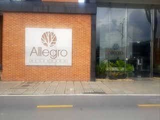 Una señal que está en el lado de un edificio en Apartamento En Venta En Bogota Santa Maria Del Lago