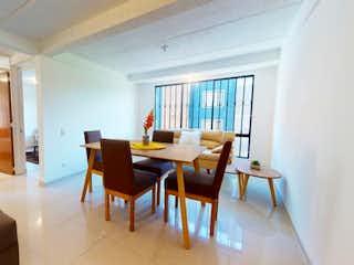 Una sala de estar llena de muebles y una ventana en Vendo Apartamento en La Giralda en Garcés Navas, Engativá.