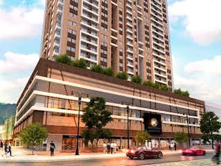 Un edificio alto con una gran torre de reloj en Apartamento en venta en San Victorino 65m² con Gimnasio...