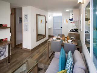Una cocina que tiene un montón de muebles en ella en Apartamento en venta en Portales Del Norte con Gimnasio...