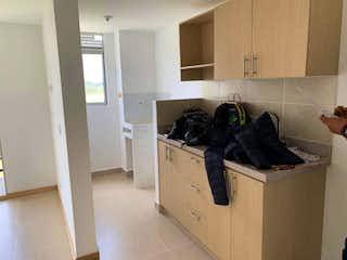 Una cocina con una estufa, un fregadero y un refrigerador en Apartamento para la venta en Rionegro