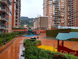 Una calle de la ciudad llena de muchos edificios altos en Apartamento en Venta SANTA TERESA
