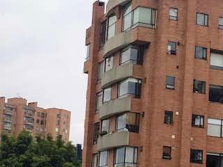 Un edificio de ladrillo alto con un reloj en él en Vendo Apartamento en Sotileza-Cerros de Suba.92Mts32 de Terraza. Yg