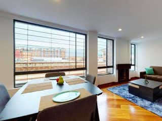 Una sala de estar llena de muebles y una gran ventana en Apartamento En Venta En Bogota Cedritos