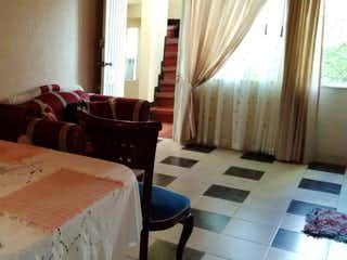Una sala de estar llena de muebles y una ventana en Apartamento en venta en Barrancas, 56m²