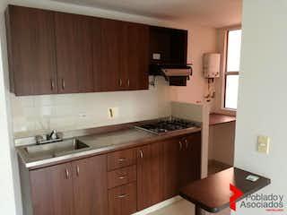 Una cocina con una estufa de fregadero y armarios en PASADENA AP 808