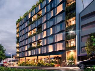 Un edificio alto sentado al lado de un edificio alto en Hashtag 98 Hotel