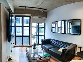 Una sala de estar llena de muebles y una ventana en Apartaestudio en Virrey de 52m2 para VENTA / RENTA (opc. amoblado)