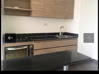 Una cocina con una estufa y un fregadero en Venta de Apartamento Sabaneta, Antioquia