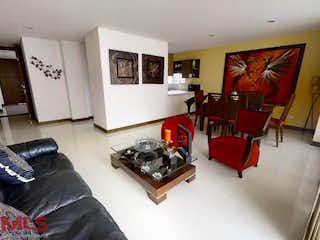 Una sala de estar llena de muebles y una televisión de pantalla plana en El Nilo