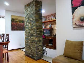 Una sala de estar llena de muebles y una chimenea en Apartamento en venta en la Loma de los Bernal