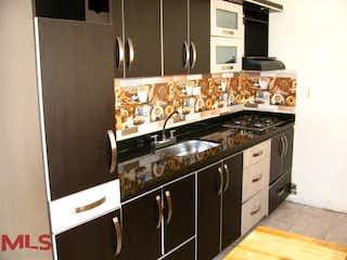 Una estufa encima del horno sentado dentro de la cocina en No aplica