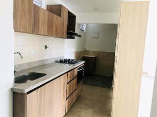 Una cocina con un fregadero y una estufa en Apartamento en Venta CALASANZ