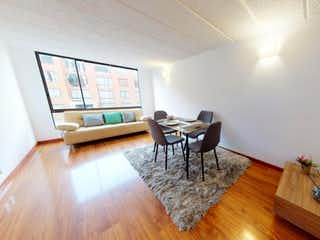 Una sala de estar llena de muebles y un suelo de madera en Vendo Apartamento en Torrecampo II en Alamos, Engativá.