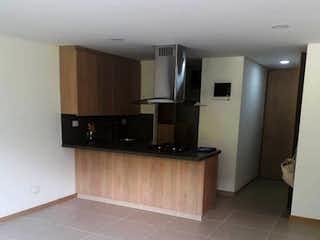 Una cocina con lavabo y microondas en Apartamento en venta en Barrio Colón 50m² con Piscina...