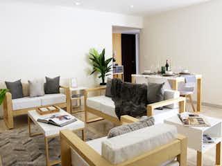 Una sala de estar llena de muebles y una chimenea en Residencial Magdalena 2