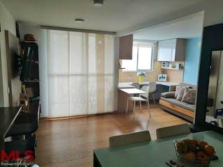Una sala de estar llena de muebles y una televisión de pantalla plana en Manzanillo